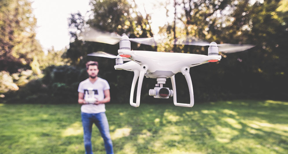 powerdms-assets-photos-031-man-flying-drone
