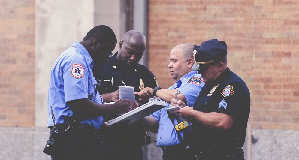 powerdms-assets-photos-081-cops-working-together