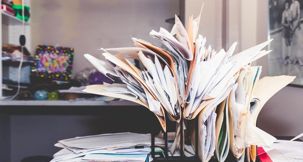 powerdms-assets-photos-018-messy-files-desk