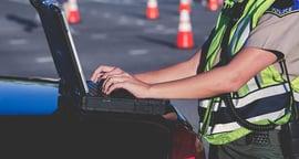 powerdms-assets-photos-025-officer-computer-car-duty