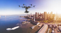 powerdms-assets-photos-027-drone-flying-city