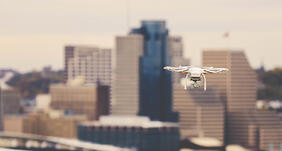 powerdms-assets-photos-043-drone-over-city-building