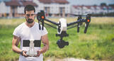powerdms-assets-photos-044-man-flying-drone