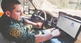 powerdms-assets-photos-045-police-officer-using-app-car-laptop