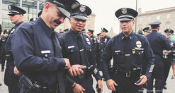 powerdms-assets-photos-056-cops-using-cell-phone