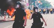 powerdms-assets-photos-062-cops-riot-gear-fire
