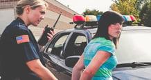 powerdms-assets-photos-063-women-cop-arrest-girl (1)