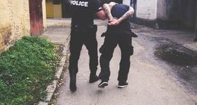 powerdms-assets-photos-065-cop-arresting-man
