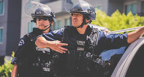 powerdms-assets-photos-069-cops-riot-gear-action