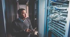 powerdms-assets-photos-080-man-working-in-server-room