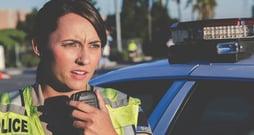 powerdms-assets-photos-082-female-officer-walkie-talkie