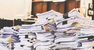 powerdms-assets-photos-117-giant-pile-of-papers