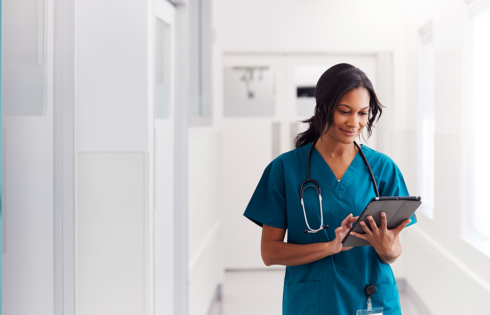 nurse on tablet device