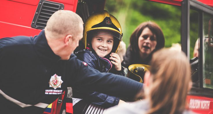 firefighter with boy