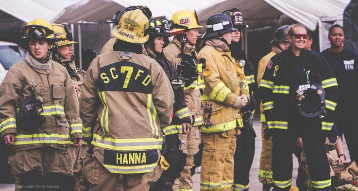 Female firefighters in full gear.
