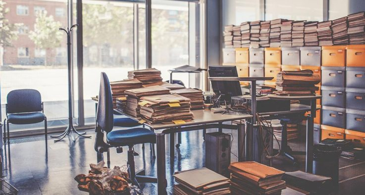 Office cluttered with policy manuals