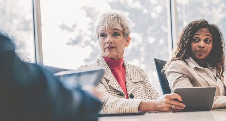 Older business woman in a meeting