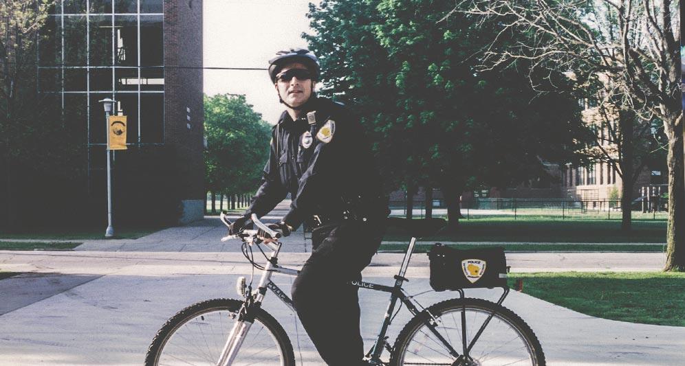 Policeman on duty riding a bike