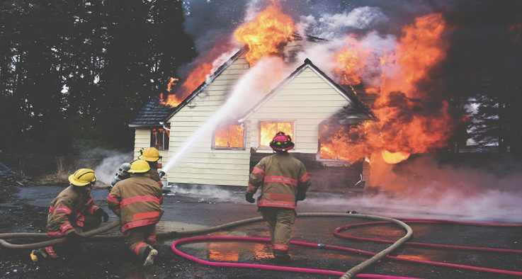 firemen putting out house fire