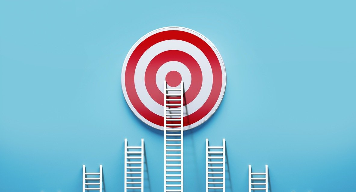 Image of 5 ladders of different sizes lined up against a blue wall. The center, and tallest ladder, is leading to the center of a bullseye.