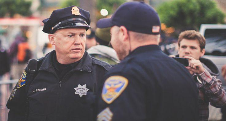 Policemen talking on duty