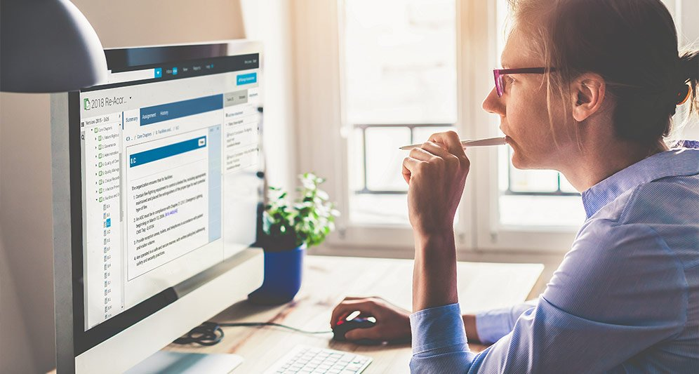Woman using PowerDMS document management software