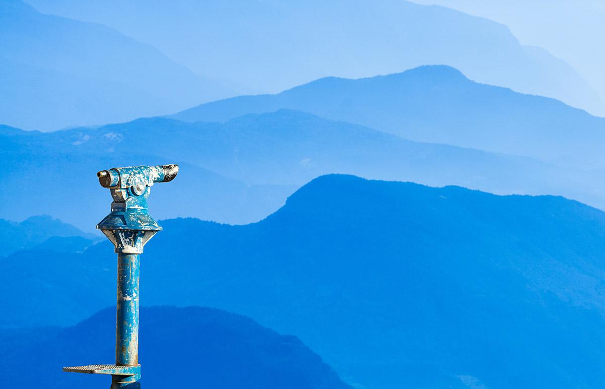 coin binoculars overlooking mountains
