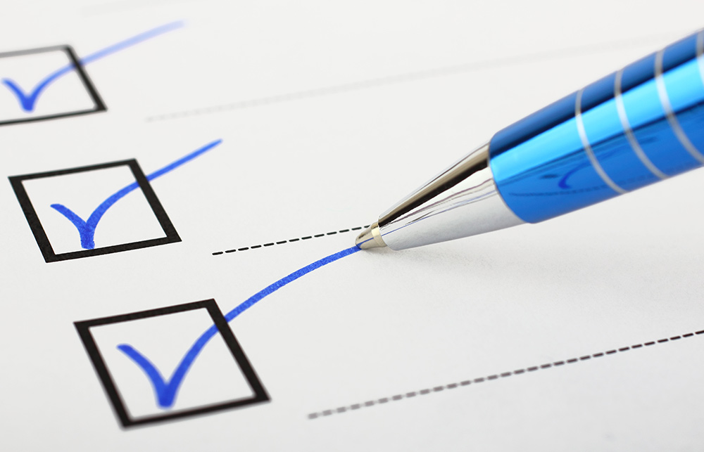 a pen checking off check boxes