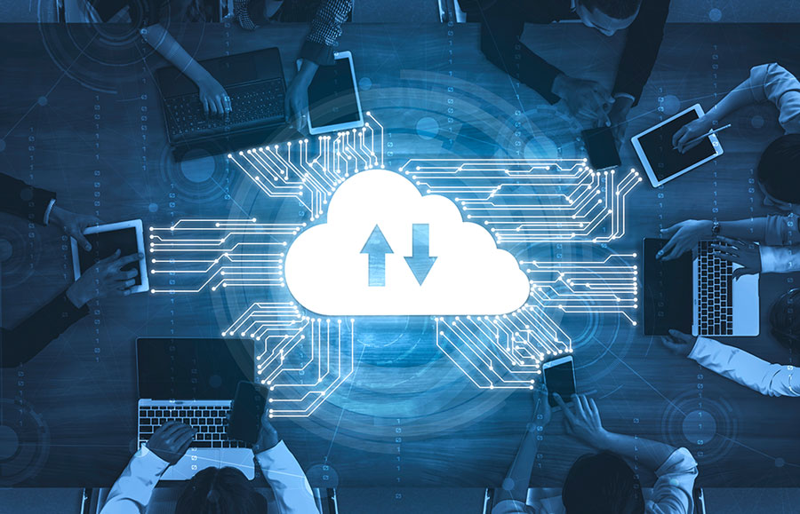 employees on laptops connecting to the cloud