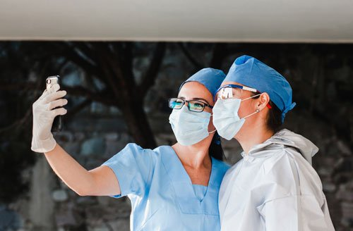 Two healthcare employees taking a selfie