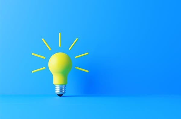 yellow lightbulb blue background