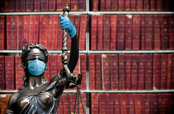 lady justice statue wearing mask and gloves